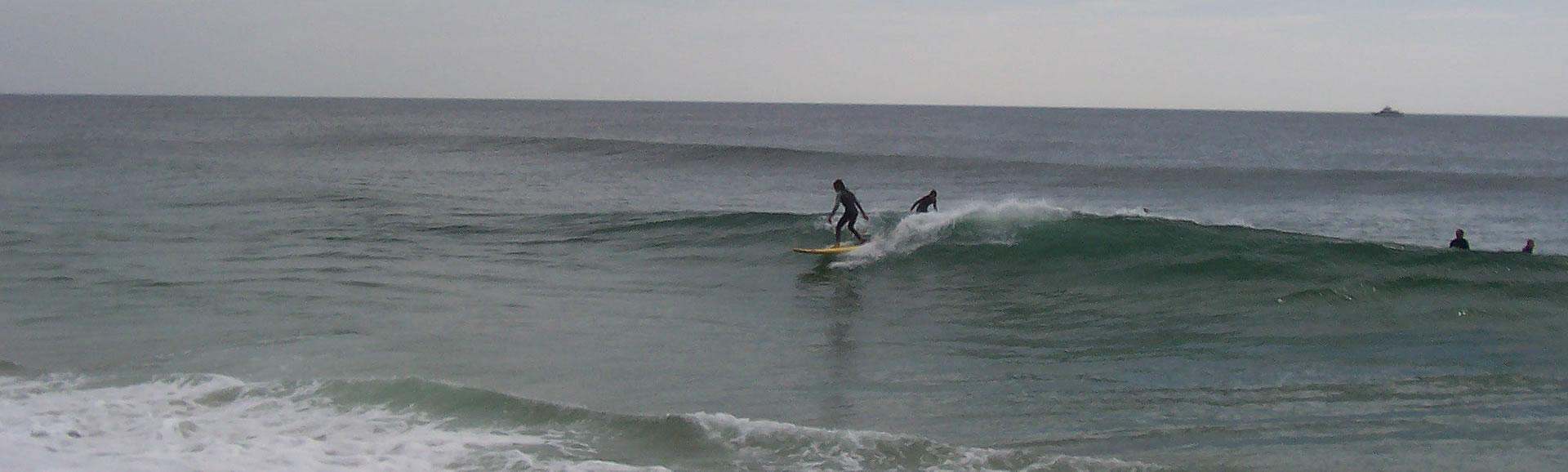 0c6e5cccf1 Kid Surfing Distance - Coastline AdventuresCoastline Adventures